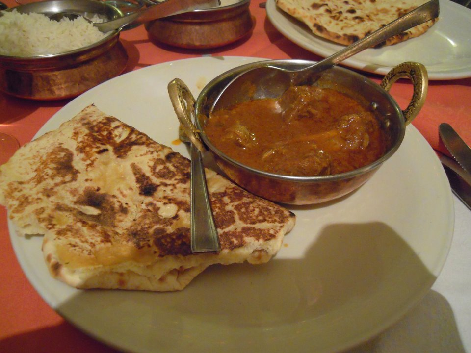 curry goat and naan in Rome, Italy