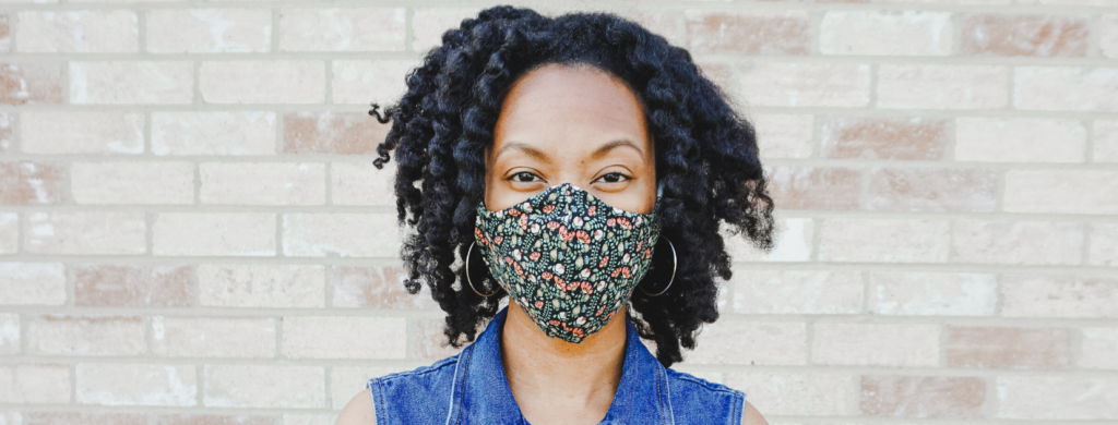 Addie of Old World New Wearing a Beya Made Face Mask due to the Coronavirus pandemic